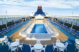 Top Deck Pool of Star Cruise Ship, Surrounded by White Tables & Chairs
